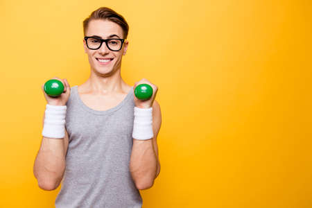Portrait of masculinity man hold dumbbells in hands and make big