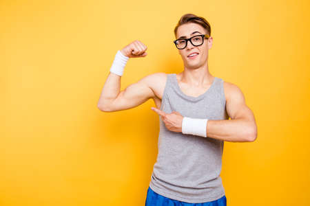 Did you see it Portrait of funny youngster man show biceps on h Stock Photo