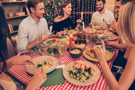 Beautiful stylish classy elegant cheerful people sitting at dinn