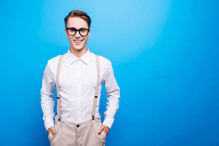 Portrait of good-looking youth man stand isolated on vivid blue Reklamní fotografie