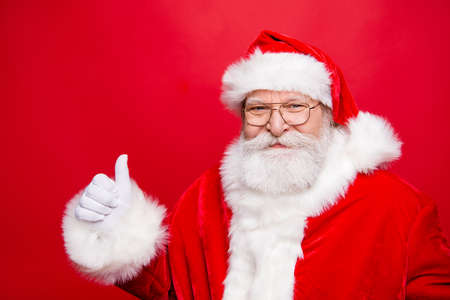 Choice choose advertising. Nice funny Santa Claus in spectacles Stock Photo