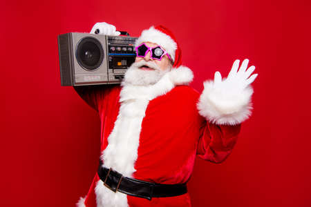 Carefree aged mature stylish Santa with white beard in costume Stock Photo