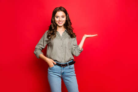 Advertising concept. Portrait of young woman in blue jeans and s