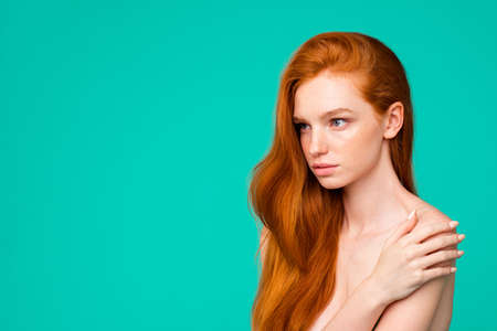 Portrait of serious nude red-haired girl with pure clean clear f