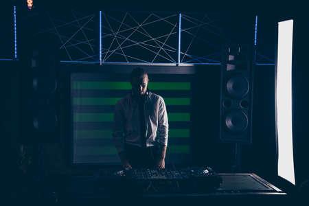 Play neon. Trendy handsome serious professional DJ, gentleman, p