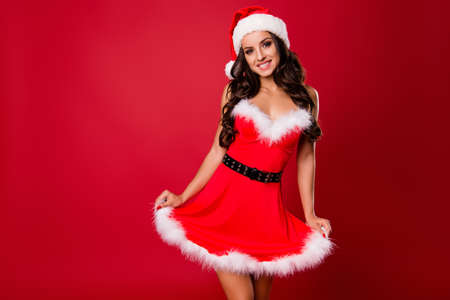 Costume party concept. Cute sweet adorable good-looking alluring lovely brunette lady with curly wave modern hairstyle look at camera make big toothy smile stand isolated on shine red background