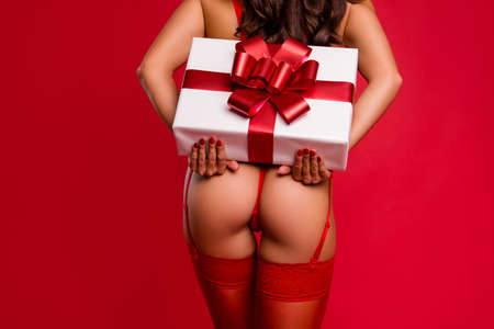 Time to give present. Back behind rear view close up cropped photo of lovely gorgeous, stunning beautiful lady hold big white box package isolated on shine red background with copy space for text Stock Photo