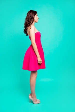 Portrait of charming, glad, lovely, brunet coquette lady in pink Imagens