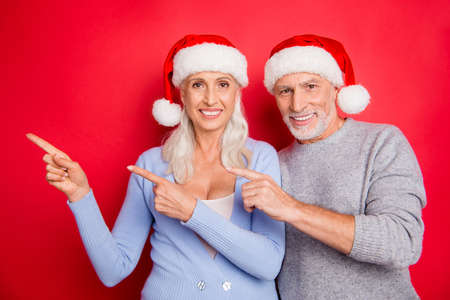 Portrait of two positive cheerful grey-haired spouses husband and wife
