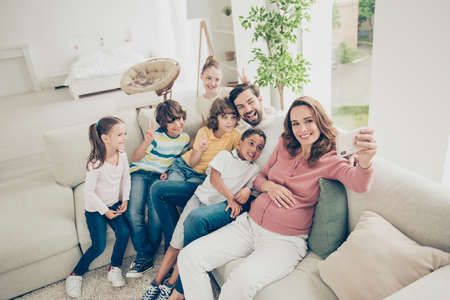 Happy family of seven people rest, relax Stock Photo