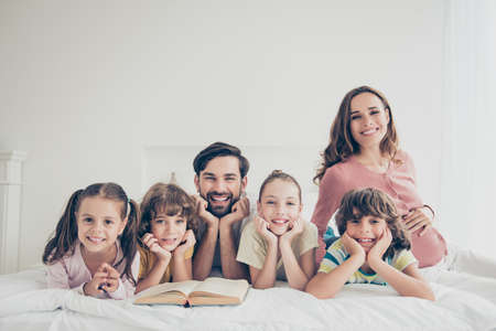 Big nice beautiful cheerful positive excited adoptive lovely family Stock Photo