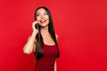 Portrait of girl posing with red background. Stock Photo
