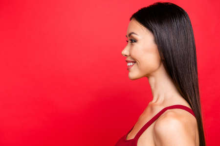 Portrait of girl posing with red background. Reklamní fotografie