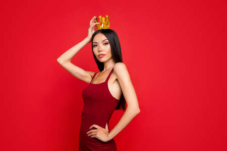 Portrait of girl posing with red background. Banque d'images