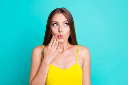 Portrait of girl posing with blue background.