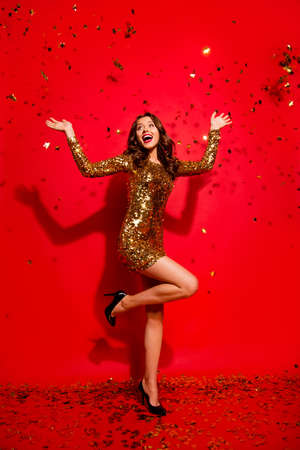 Portrait of woman posing with red background. Imagens