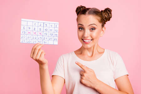 Portrait of girl posing with pink background.