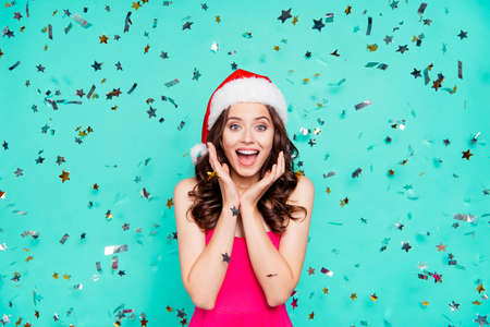 Carefree, careless, Christmastime win, winner concept. Portrait of astonished, stylish, trendy, beautiful, wow face brunette lady with modern curly hairdo isolated on shine turquoise background