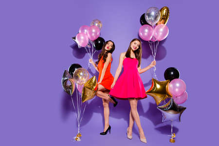 Congratulations, greeting concept. Full length, legs, body, size portrait of two people person in fuchsia, red formal wear on sharp, pumps, stilettos isolated on bright purple background Foto de archivo
