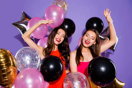Careless, carefree concept. Two dream, dreamy ladies with balloons