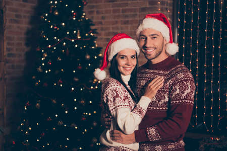 Beautiful, sweet, charming, cute couple in ornament sweater Stock Photo