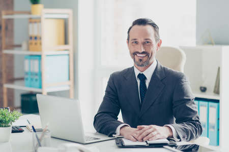 Confident success handsome good-wearing style stylish man in chic formalwear sit on comfort armchair behind desktop in bright white office make beaming toothy smile Foto de archivo - 150049561