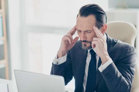 Half turn unhealthy unhappy analyst banker broker chief ceo brunet hair bristle man in formalwear style elegant tuxedo feel bad close eyes touch temple Foto de archivo - 150049818