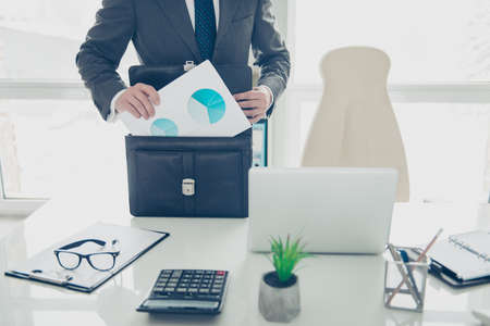 Cropped photo of expert man in formalwear prepare to conference fold papers into a briefcase Standard-Bild