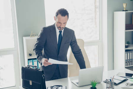 Photo of chief ceo occupation professional man in classy trendy tux formal wear look at contract ready to go on conference Foto de archivo - 150049944