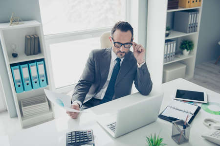 High angle top view attractive agent ceo economist employee man in trendy style chic classy formalwear look on pc gadget screen monitor hold conference blank sit on chair armchair behind table