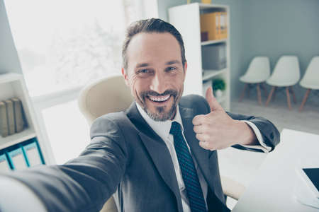 Good-looking brunet hair stubble man in trendy style stylish formalwear take selfie demonstration show symbol gesture trust recommend make beaming toothy smile