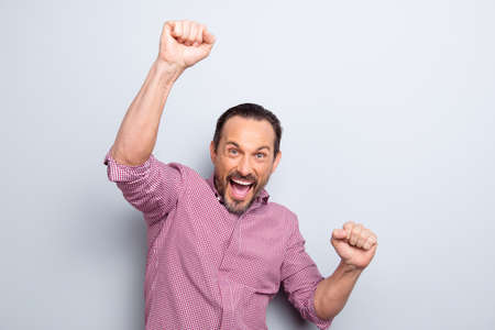 Good-looking funky mood trendy stylish man look at camera hold hands up make hollywood smile and wide open mouth isolated on light gray background