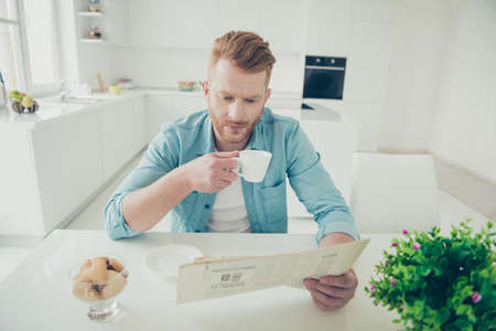Good-looking stylish trendy man enjoy delicious coffee and baker