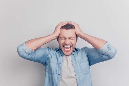 My head ready explode Photo of bad feeling man with closed eyes