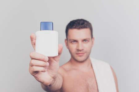 Close up photo with focus on white bottle lotion with blurred ma