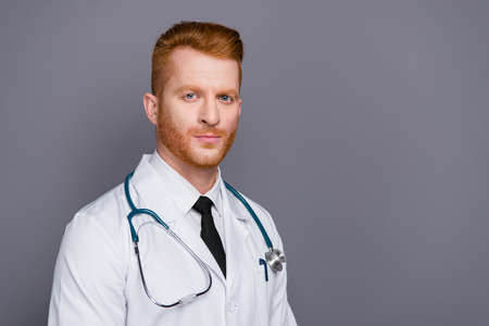 Half turn portrait of handsome attractive doctor isolated on dar