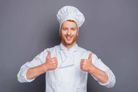Friendly grinning man demonstration thumbs up on two hands like 版權商用圖片 - 112274965