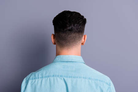 Rear back view of attractive handsome man wearing blue formal sh