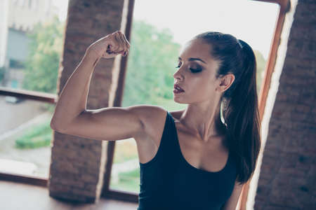 Portrait of adorable beautiful strong model. sporty slim dreamy girl Stock Photo