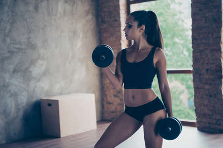 Crossfit attractive pretty fitness model with brunette ponytail