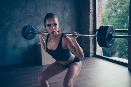 confident fitness girl exercising