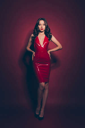 Full length body size vertical elegant brunette wearing red dress