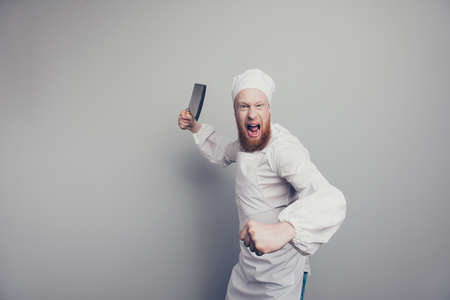 Portrait of crazy mad attractive handsome butcher guy holding kn Stock Photo