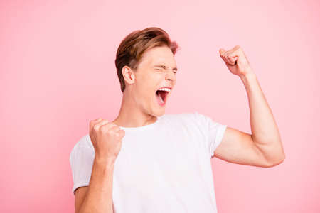 Attractive man in casual white t-shirt closed eyes raised hands Stok Fotoğraf