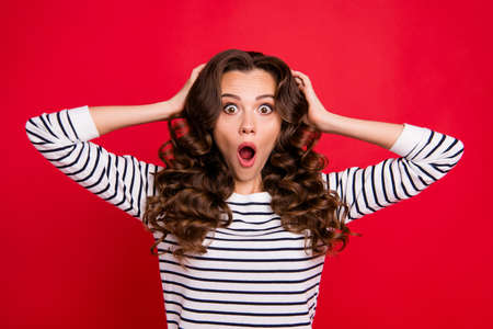 Close up portrait of wow pretty cheerful yelling with voice she her girl do not know what to do with broken cup wave hair on shoulders white striped pullover isolated on red vivid background