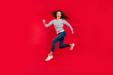 Full length size body photo of fly high attractive beautiful she her girl want to be in time for black friday sale discount wearing white casual sweater on red vivid bright background