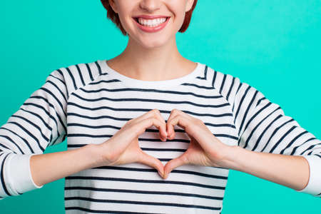 Cropped close up portrait of beautiful cute foxy she her lady fingers hands making figure form of heart really glad to have healthy heart wearing white striped pullover isolated on teal background