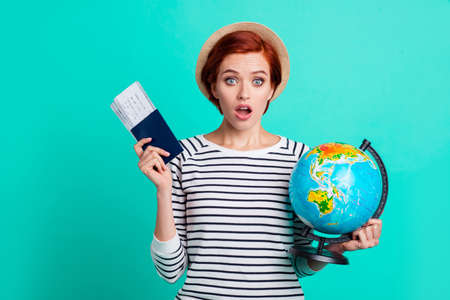Earth people rest relax resort recreation hot weather concept. Afraid panic stupor speechless with open mouth she her holding document two train tickets globe in hand isolated turquoise background