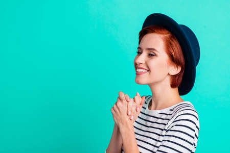 Side profile closeup photo portrait of beautiful pretty attractive cheerful positive optimistic emotional she her lady looking aside isolated turquoise background copyspace Stock Photo