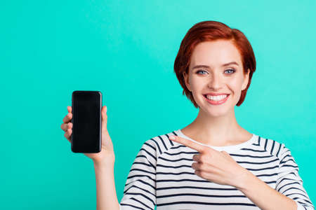 Close up portrait of cheerful attractive she her lady with telephone in hand new model of apple telephone just have look at price wearing white striped sweater isolated on teal background